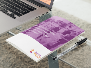 bifold-brochure-mockup-lying-next-to-a-laptop-in-an-office-a10308